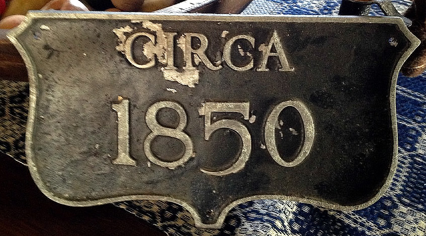 Note the over 50 areas of the deteriorated finish in this cast aluminum historic house plaque.