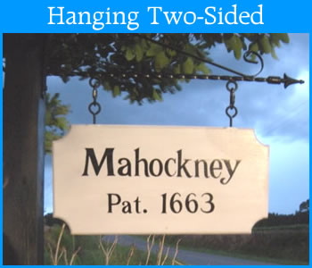 two-sided hanging painted historic house signs