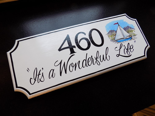 wooden hand painted house number sign